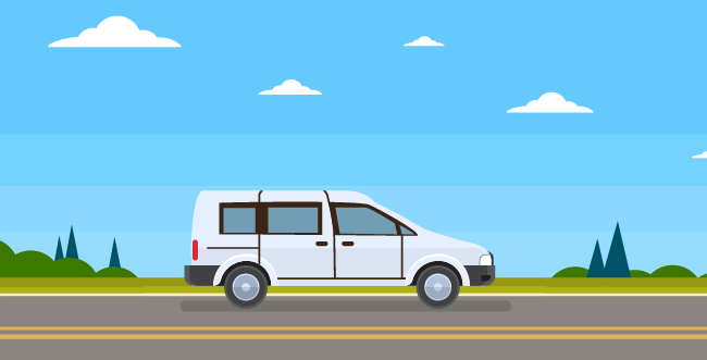A silver van on a road