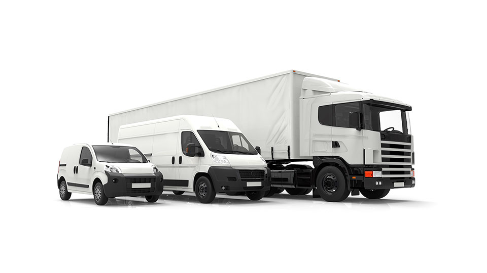 A car, a deliver van and a transport truck next to each other