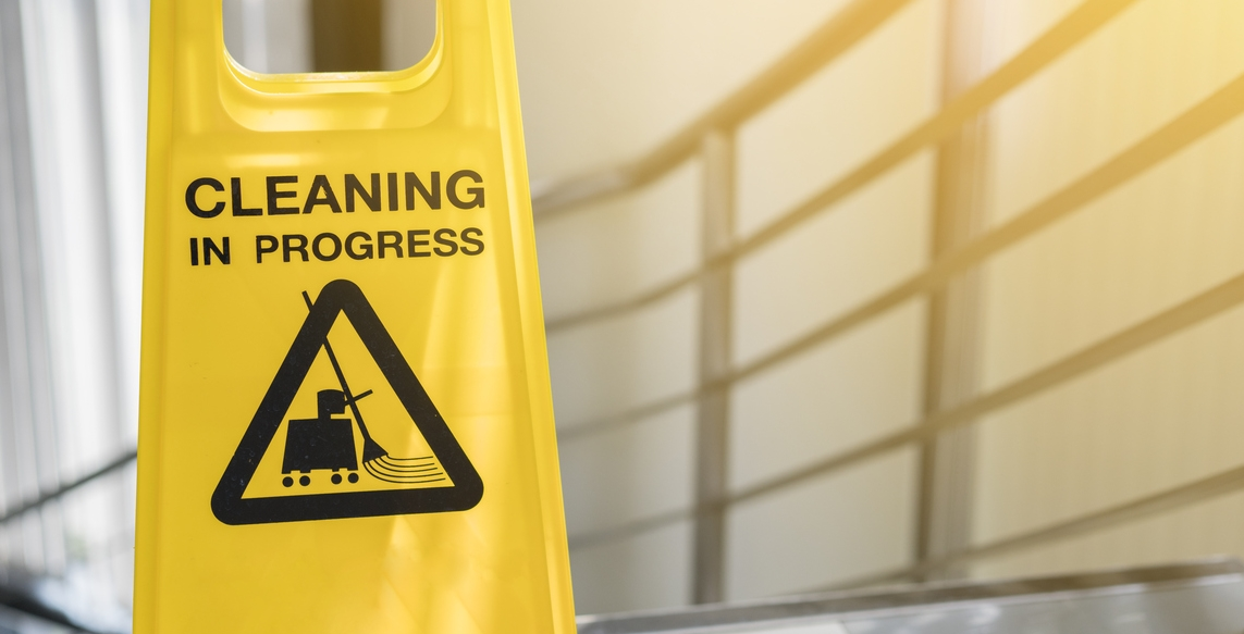 "Image of a wet floor sign with ""cleaning in progress"" on it"
