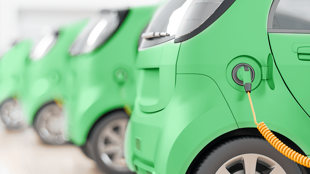 Green EV being charged