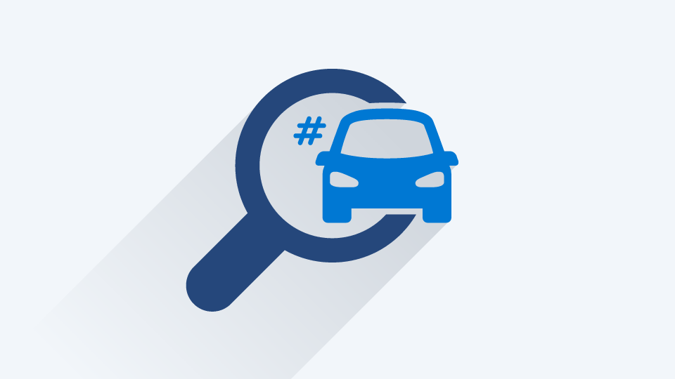 Graphic of a black magnifying glass over a black vehicle
