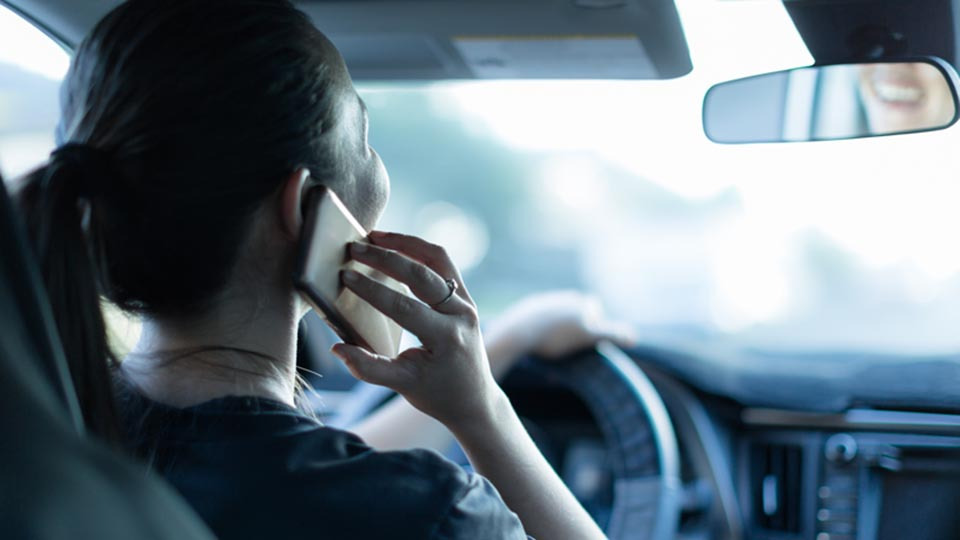 Woman distracted driving on her cell phone