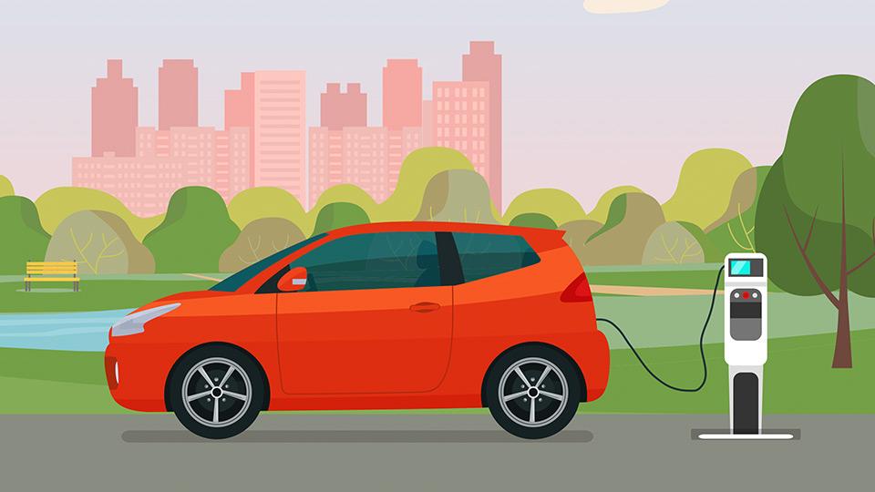 coche eléctrico rojo cargándose en un parque
