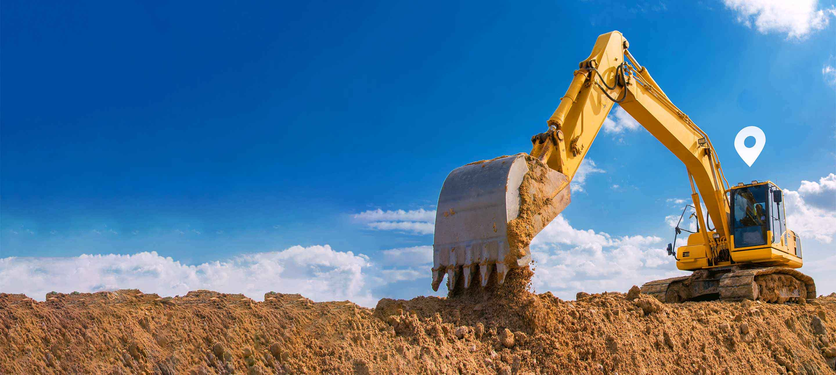 Yellow excavator picking up dirt being tracked using Geotab software