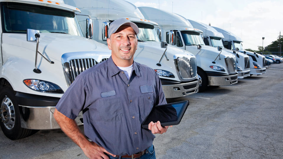 Man standing in front of truck lineup