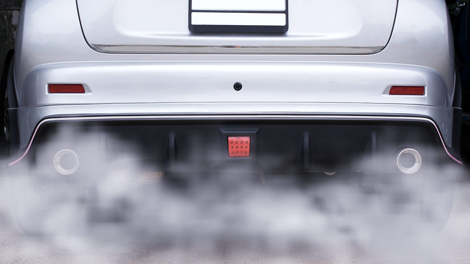 Rear end of a vehicle with dual exhaust pipes