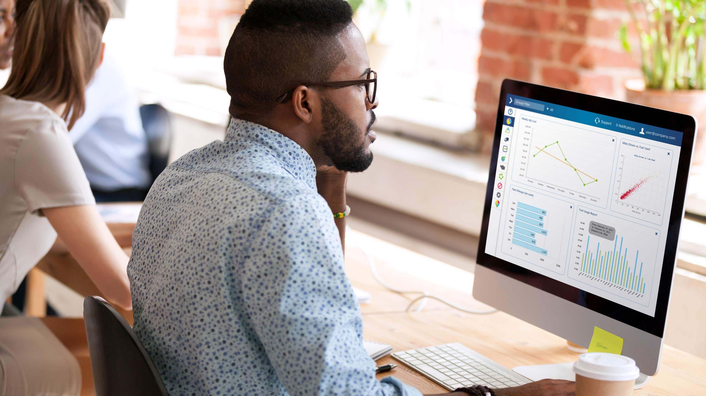 Man using MyGeotab interface on desktop computer