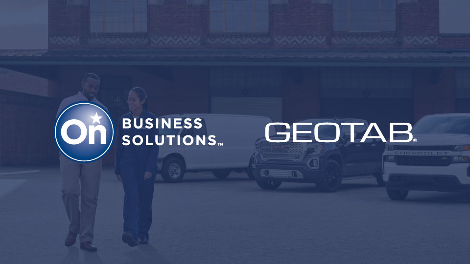 A photo of two people walking and talking in a parking lot with a dark blue overlay and the  General Motor's OnStar logo and Geotab's logo positioned side-by-side