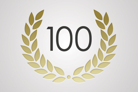 the number 100 in the middle of gold royal greek leaves