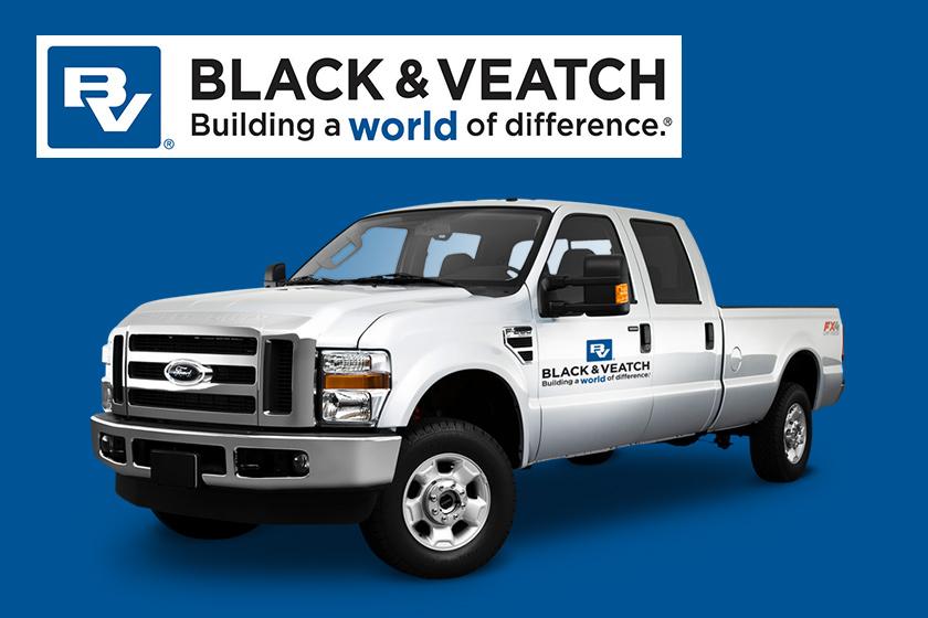 Black and Veatch branded pickup truck on dark blue background