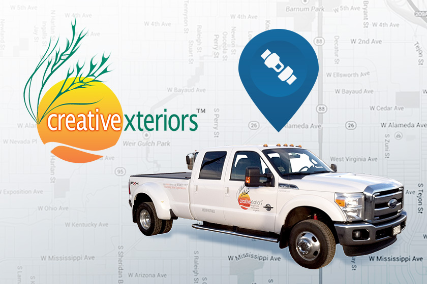White CreativeXteriors pickup truck with blue GPS icon above it