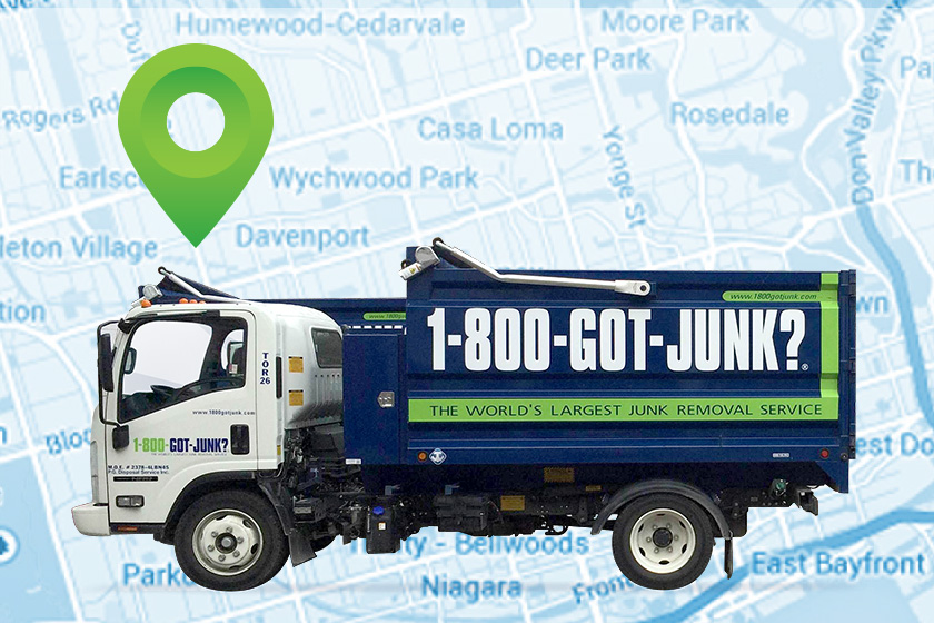 Garbage truck on blue map background with green GPS icon above it