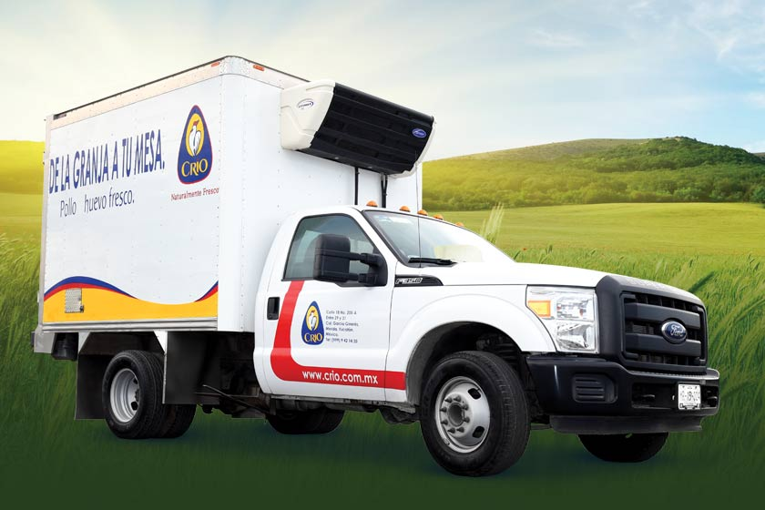 Grupo Crio-branded truck superimposed over rolling hills of green grass