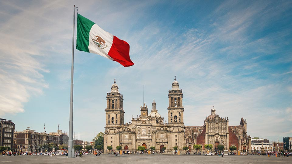 Flag of Mexico in front of building