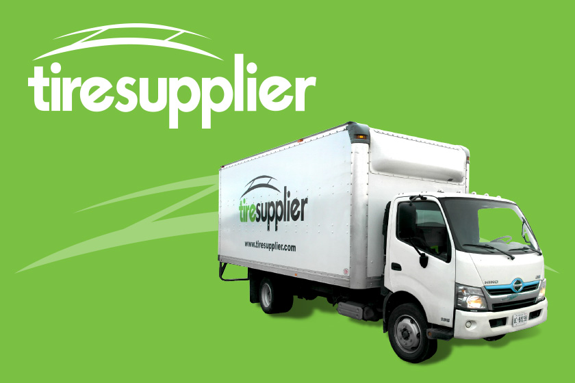 White Tire Supplier truck on a green background with Tire Supplier logo above it