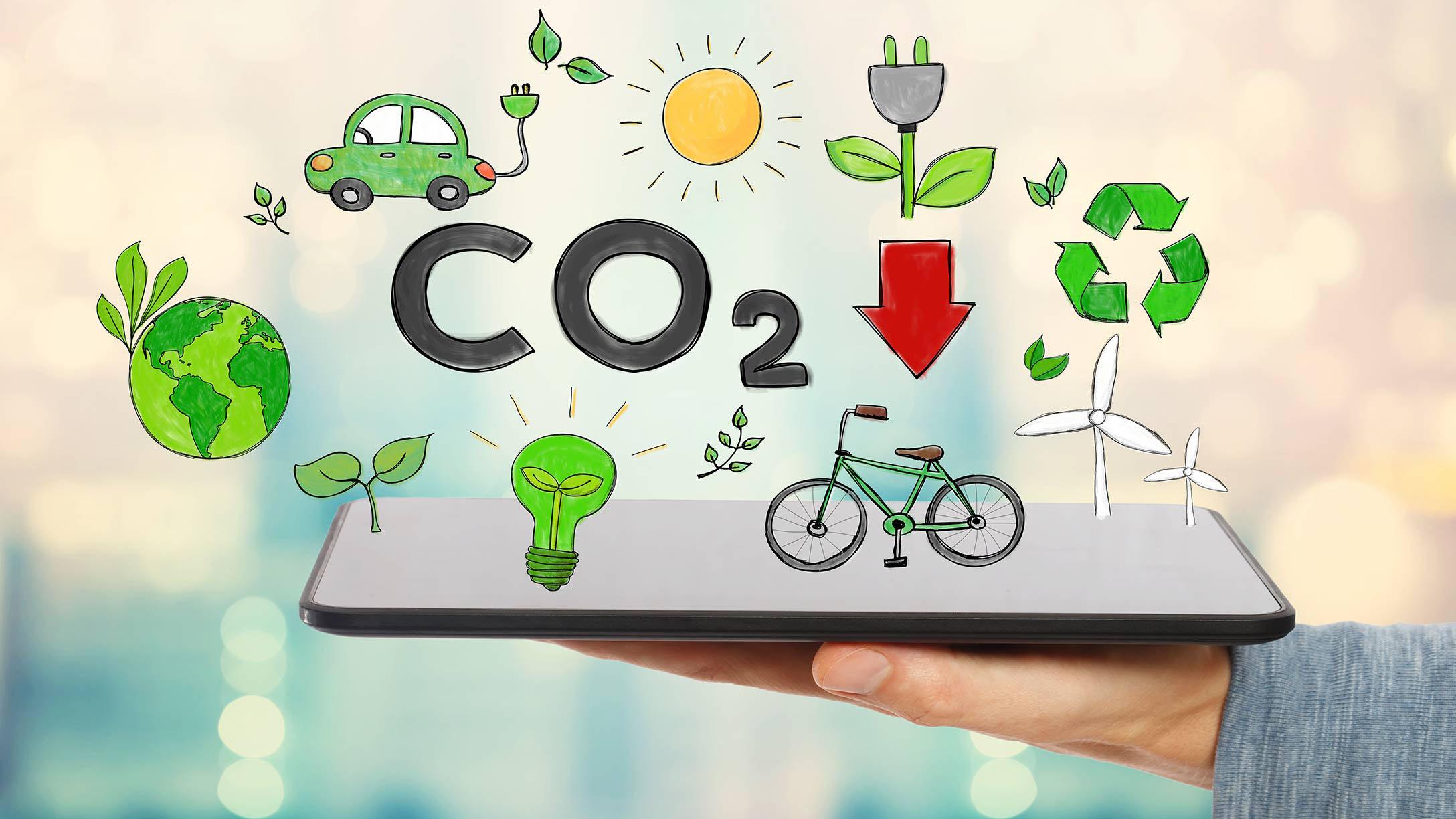 Tablet mit mehreren Symbolen wie CO2, Fahrrad, grüner Planet und mehr.