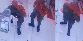 Ghanaian soldier captured on camera stealing iPhone from phone shop