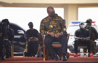 Mahama 'Kneels' Before Akufo-Addo At Rawlings' Funeral