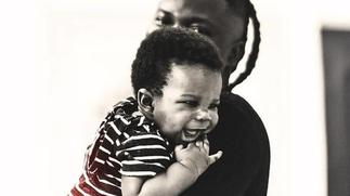 Stonebwoy compares his childhood photo to his son, Davido reacts [ARTICLE]