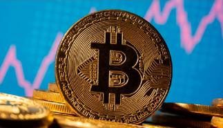 Bitcoin slips sharply from record highs
