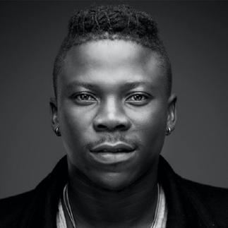 Tommy Hilfiger styles Stonebwoy for his record-breaking music video