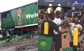 Video of Ghanaian Men Happily Drinking From Fallen Beer Truck On Motorway Goes Viral