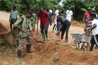 MP leads residents to fix bad roads as gov't delays