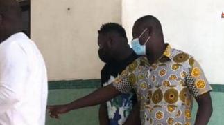 Medikal handcuffed to court