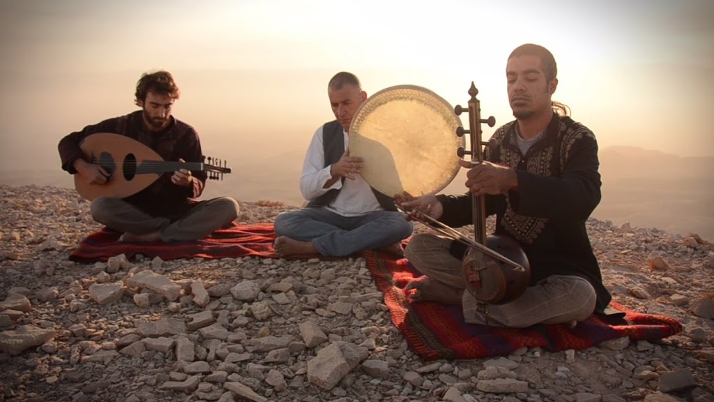 A band playing instruments from around the world