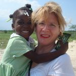 Sobus enjoys a visit with Metinise, a Haitian girl she sponsors through a local charity