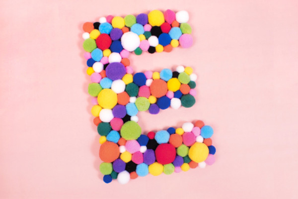 Decorate letters with pompoms