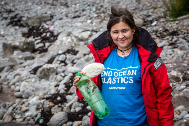 Greenpeace activist with plastic bottle