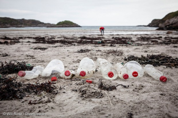 Empty plastic Coke bottles discarded on a beach