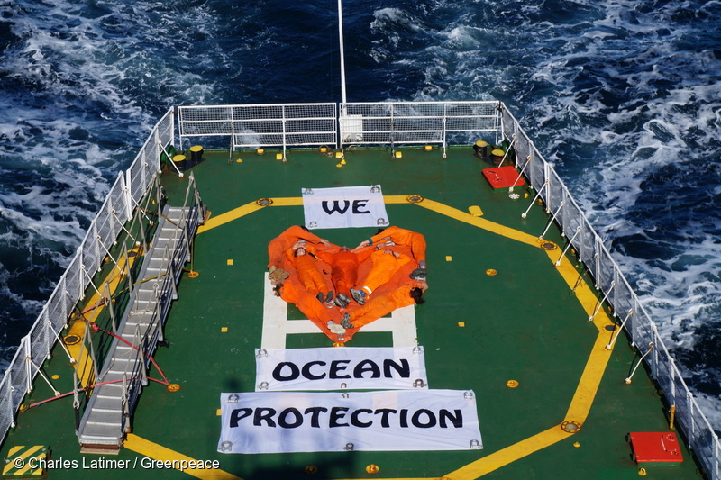 "Banner reading ""We Love Arctic Protection"" on the helideck of Arctic Sunrise."