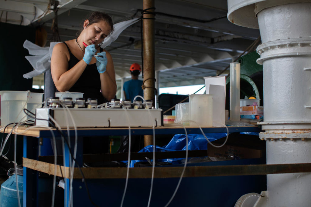 Maria Nóbrega, microbiologist from Federal University of Rio de Janeiro (UFRJ) prepares water samples for bacterial studies on board the Greenpeace Esperanza, as part of the latest research expedition to the Amazon Reef.