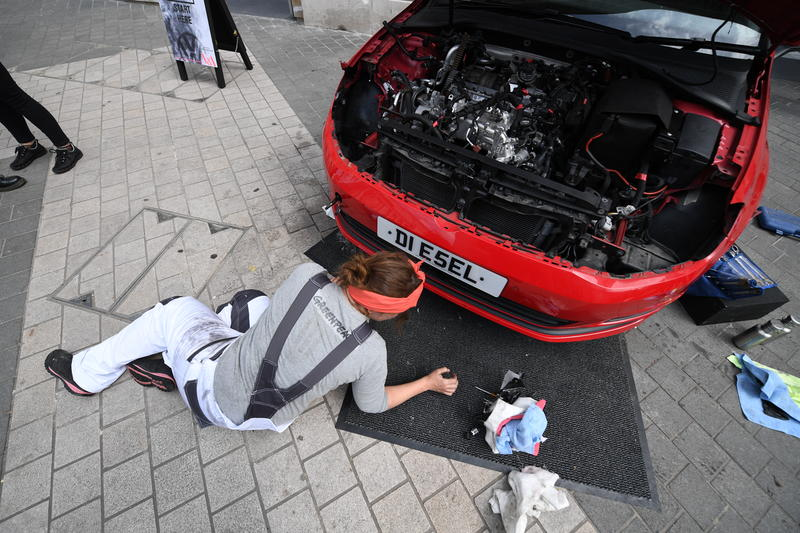 Four women dismantle a VW Golf TDI diesel car at an unofficial fringe exhibition at the V&A to protest against Volkswagens continued support of polluting diesel engines.