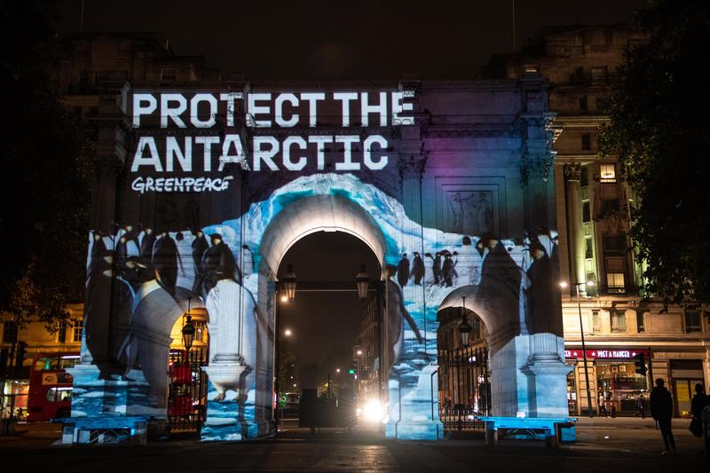 Greenpeace activists project an Antarctic-themed animation and stream music at Marble Arch in central London.