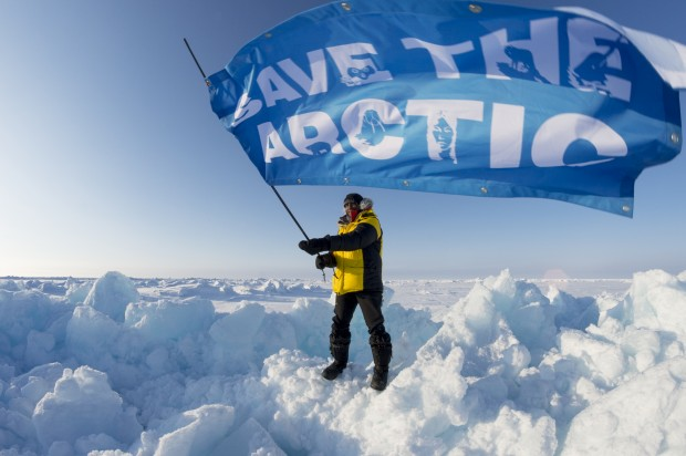 Man with Save the Arctic flag