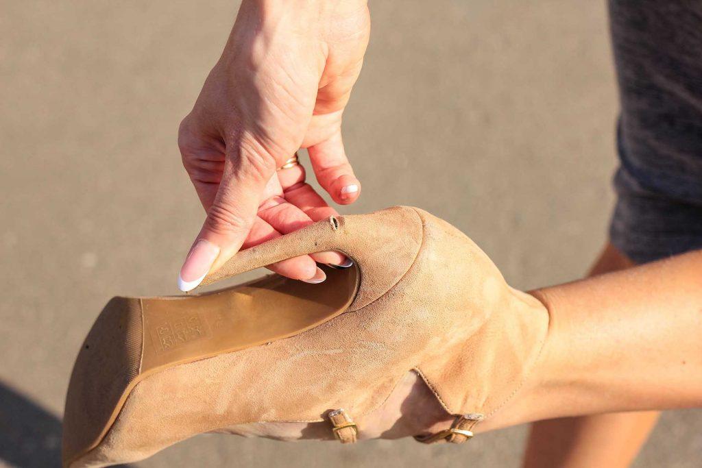 lindsay giguiere, fixing a broken high heel