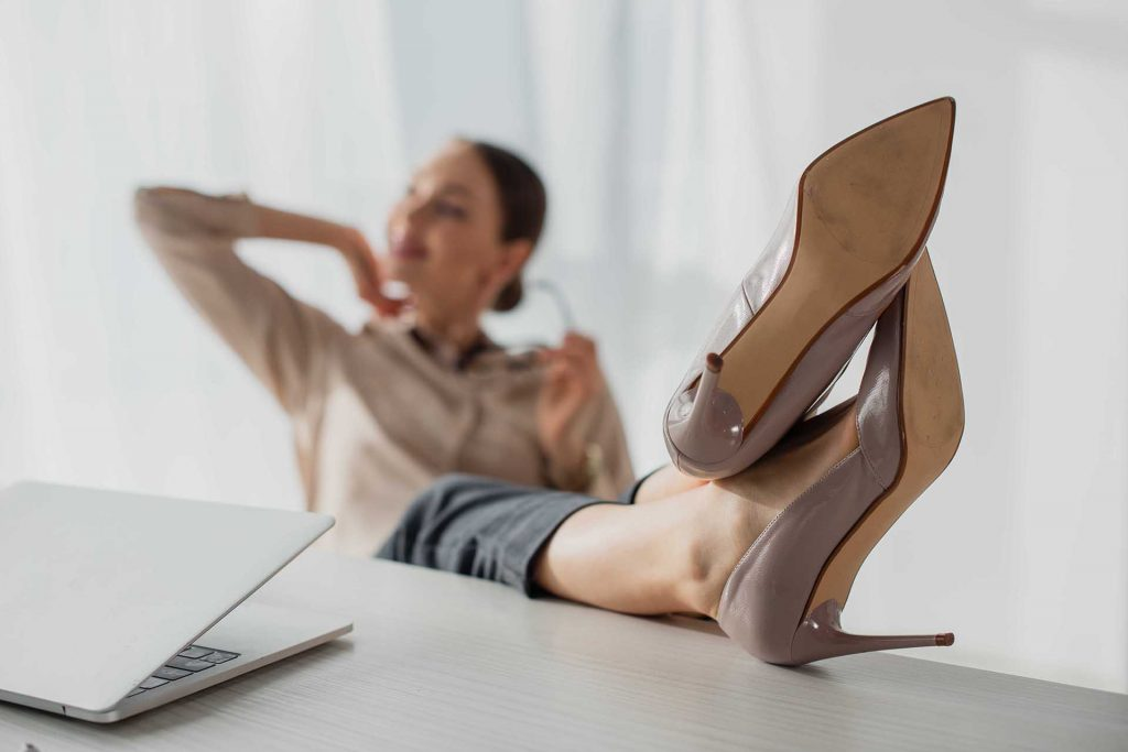 lindsay giguiere, relaxing with feet on desk