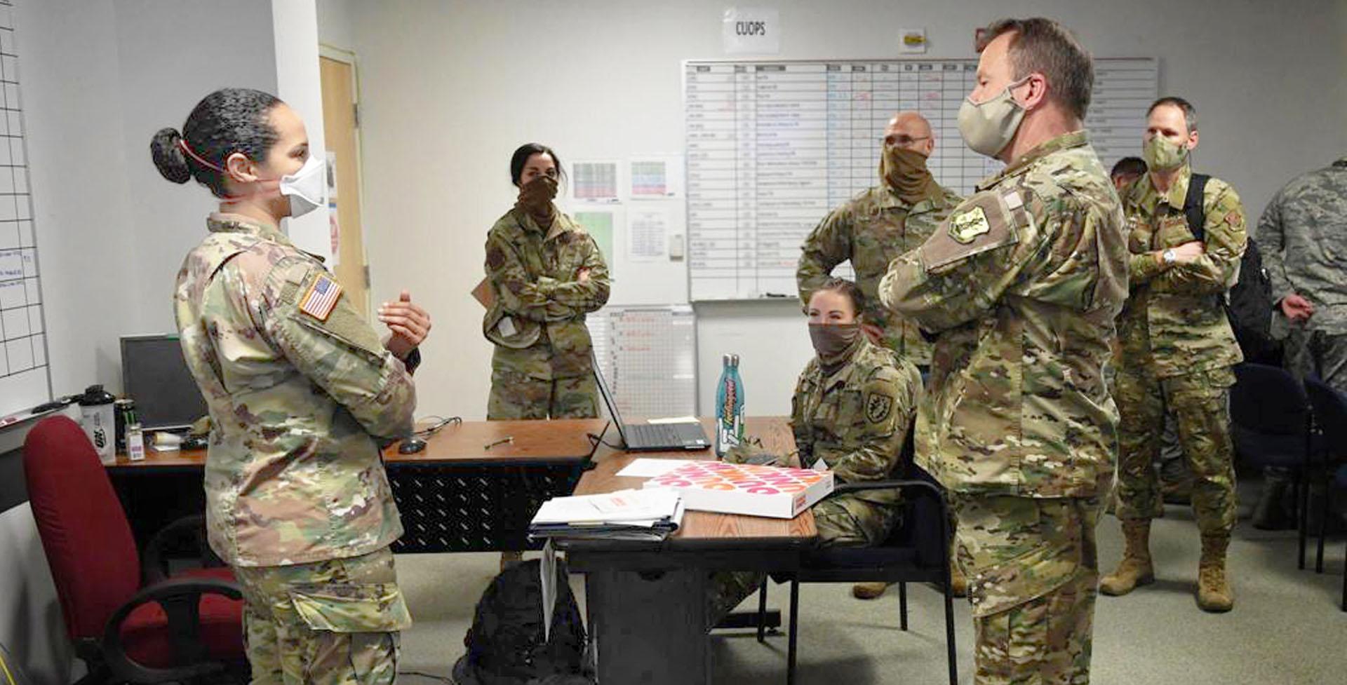 lindsay giguiere, steve januario and rasheeda bilal in action as air national guard members