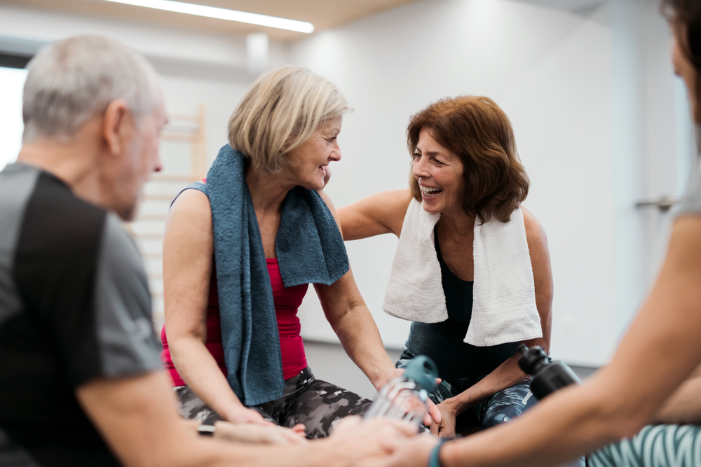 Seniors laughing together in a fitness class