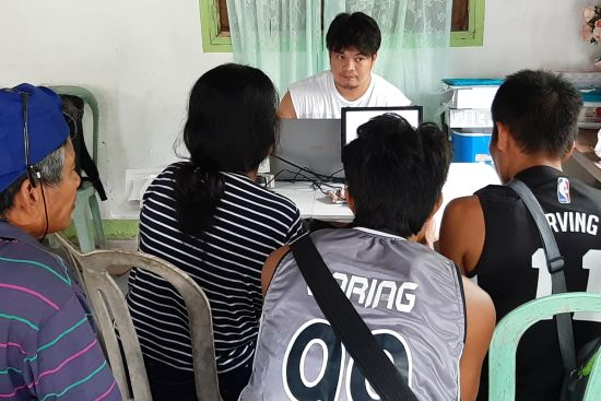 <p>Mindoro Islanders teamed with GRN workers for the time intensive and essential job of translating and checking translations.
