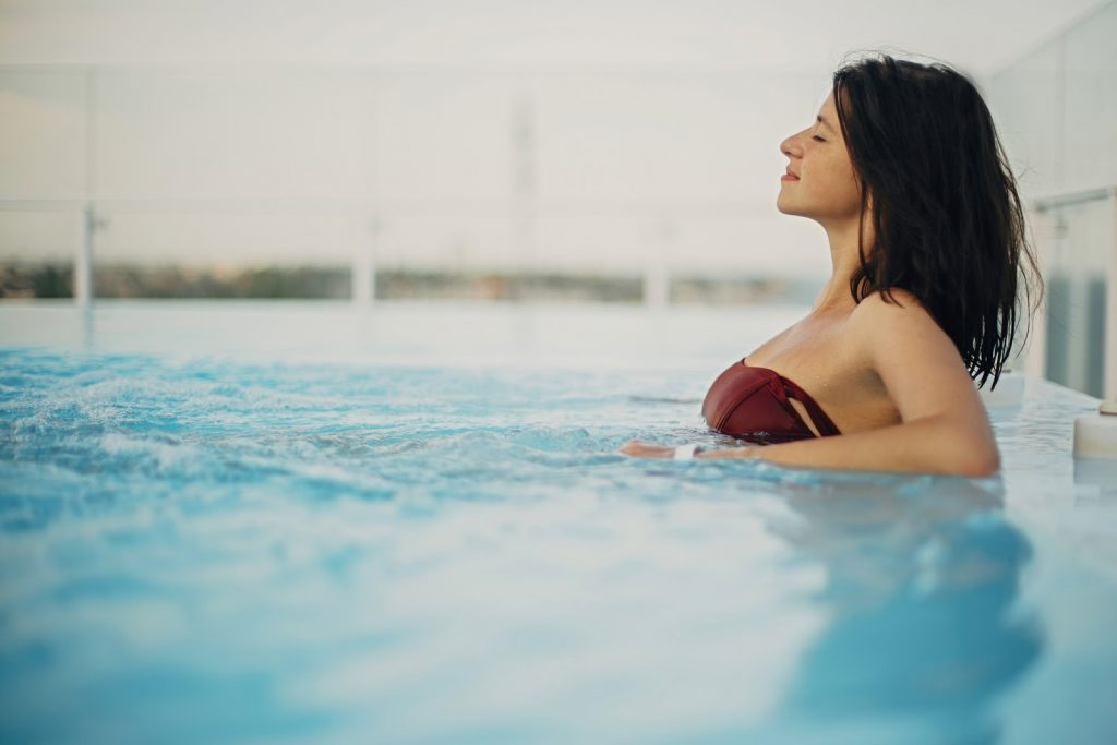 Young woman prioritizing her health and wellness in a pool