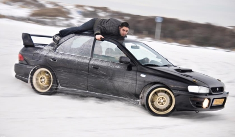Video Crazy Guy on Roof of Snow Drifting Subaru