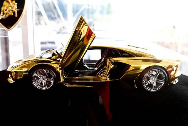 $7.3 Million Gold Lamborghini Aventador Awaits New Buyer in the UAE on gold chrome lamborghini aventador, pure gold bugatti, pure gold audi, gold plated lamborghini aventador, bugatti aventador, pure gold lamborghini cars, pure gold ford fusion, real gold lamborghini aventador, liquid gold lamborghini aventador, pure gold ford ranger, rose gold lamborghini aventador, pure diamond lamborghini, pure gold range rover, pure gold lamborghini veneno,