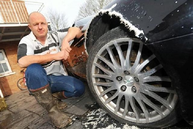 Dog chews Hole through Wheel Arch of Owner's  Aston Martin DB9 Volante