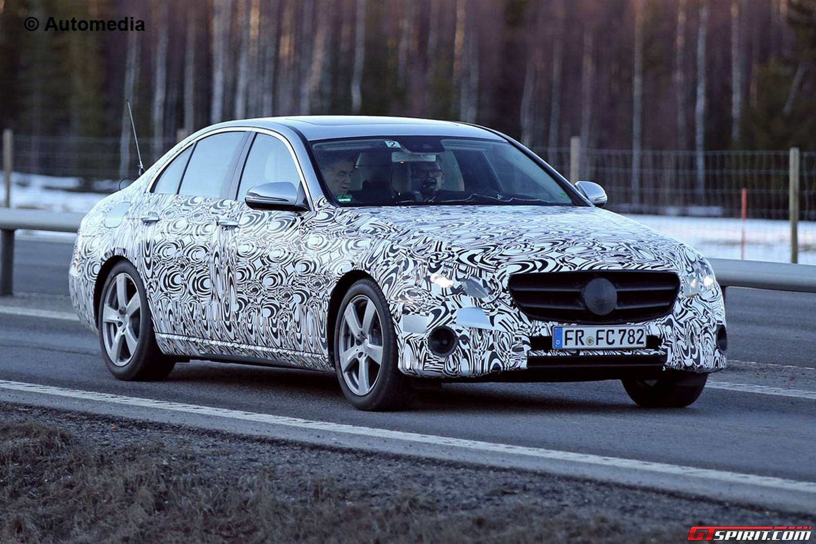 Next gen mercedes benz e class sheds camo in new spy shots for Mercedes benz class e