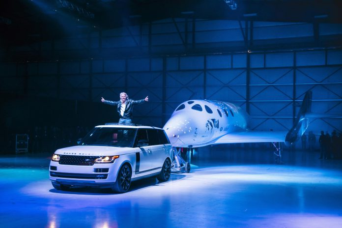 Virgin Group founder Richard Branson unveiling the new VSS Unity, towed by a Range Rover Autobiography