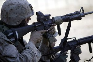US Marine looking through an ITL MARS reflex sight